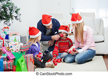 Family With Christmas Gifts And Ornaments