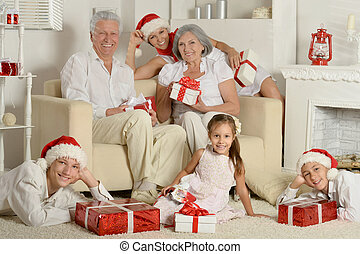 Family with christmas presents