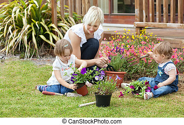 Family with colorful flowers in the garden