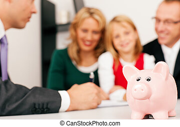 Family with their consultant (assets, money or similar) doing some financial planning - symbolized by a piggy bank in the front (focus only on piggy bank!)