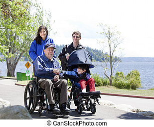 Family with disabled senior and child walking outdoors