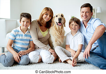 Family with dog - Portrait of happy family with their pet...