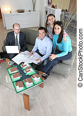 Family with estate agent