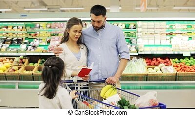 family with food in shopping cart at grocery store - sale,...