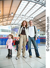 family with girl in airport