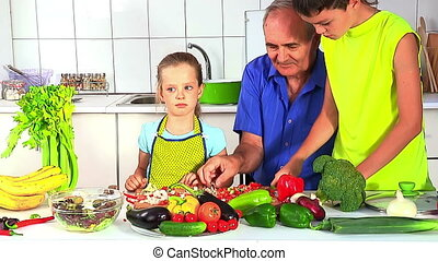 Family with grandfather children cooking at kitchen. -...