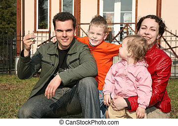 family with house key