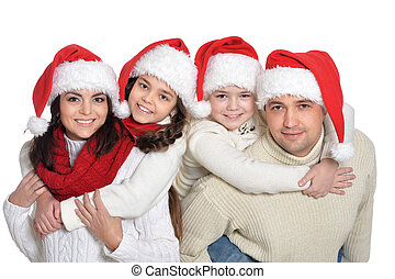 Family with kids in santa hats on white background