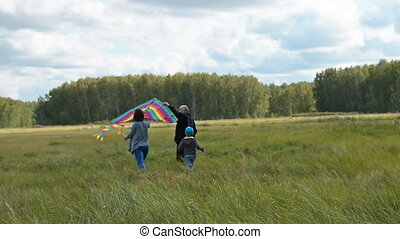 Family with kite outdoor