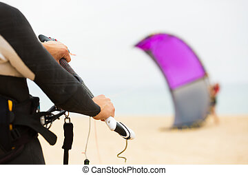 Family with kiteboard at the beach