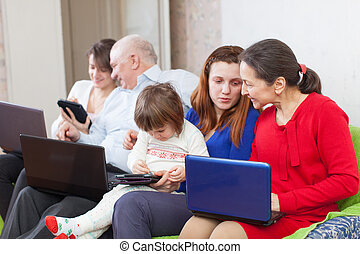 family  with laptops at home