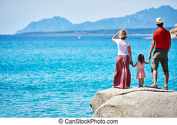 Family with little child on sea vacation