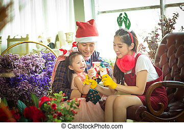 Family with little girl in coffee Time.