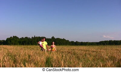 family with little girl in field