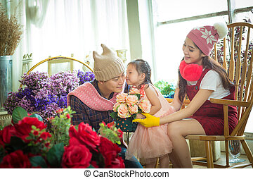 Family with little girl in garden.