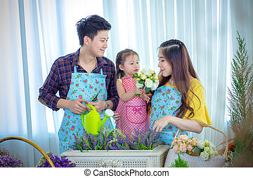 Family with little girl in Play gardening.