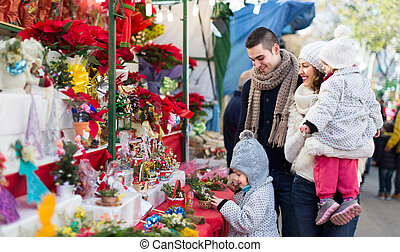 Family with little girls at floral market