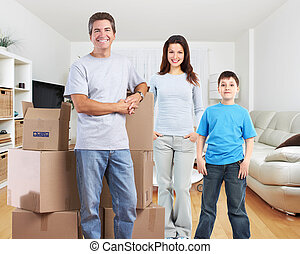 Family with moving boxes in new apartment.