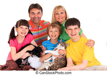 Family with pets - Portrait of a happy family with pets. ...