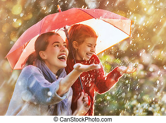 family with red umbrella - Happy funny family with red...