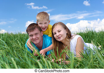 family with son on the meadow