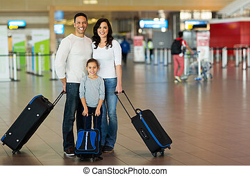 family with suitcases at airport - happy family with...