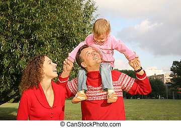 family with the daughter, who sits on the shoulders of the father