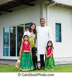 Family with their new house.