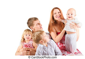 family with three children is sitting on a chair. little boy looking at baby. isolated.