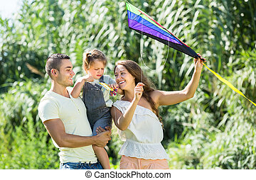 Family with toy kite at park
