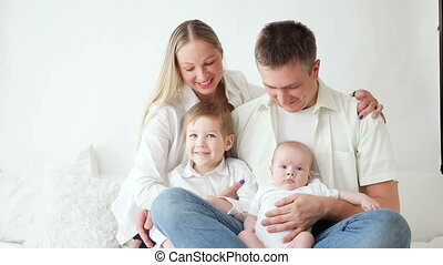 family with two sons sitting at home