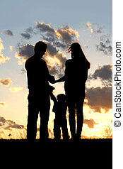 Family with Young Child Silhouette at Sunset