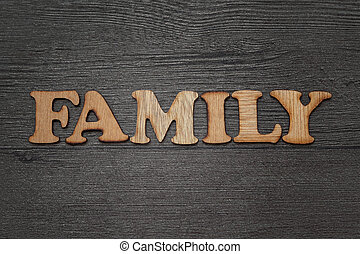 Family words text concept wooden letterpress type