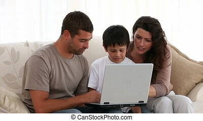 Family working on their laptop