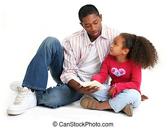 Family Worship - African American father and daughter...