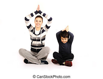 Family - young woman and kid - doing sport, fitness exercises