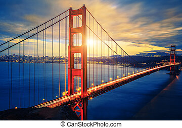 famoso, puente de la puerta de oro, en, salida del sol