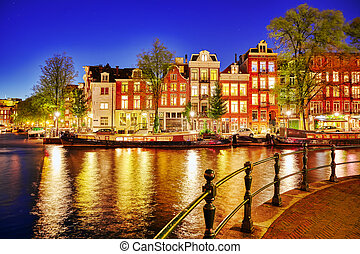 Famous Amstel river and night view of beautiful Amsterdam ...