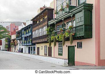Famous ancient colorful balconies decorated with flowers in Santa Cruz de La Palma.