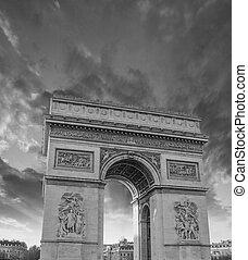 Famous Arc de Triomphe in Paris with Dramatic Sky