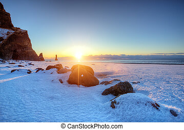 Famous Black beach in Iceland with beautiful sunrise light