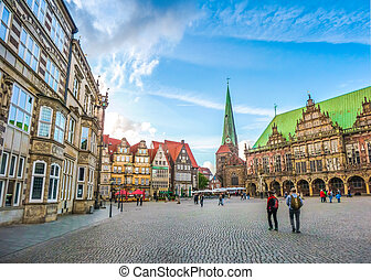 Ancient Bremen Market Square in the centre of the Hanseatic City of Bremen with view on famous Raths-Buildings, Church of Our Lady (Unser Lieben Frauen Kirche) and town hall, Germany