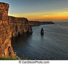 famous cliffs of moher, sunset, county clare, ireland -...