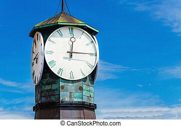 Famous clock on Aker Brygge, modern Oslo, Norway