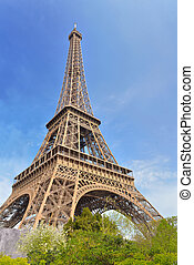famous eiffel tower on the blue sky in Paris - France