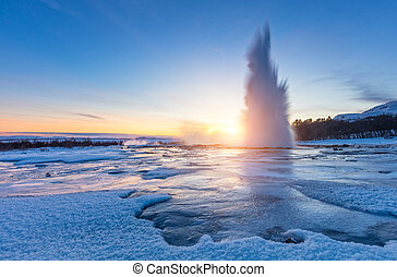 Famous Geysir in Iceland in beautiful sunset light. One of...