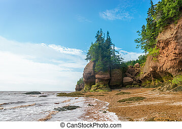 Famous Hopewell Rocks flowerpot formations at low tide (New...