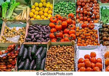 Famous La Boqueria market with vegetables and fruits in...