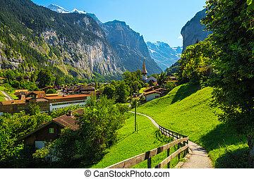 Famous Lauterbrunnen village in the deep valley, Bernese Oberland, Switzerland