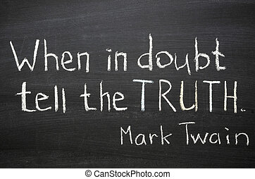 "famous Mark Twain quote ""When in doubt tell the truth"" handwritten on blackboard"